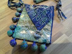 Bag. Metallic thead machine stitch.hand felted balls.