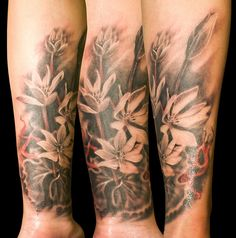 Flower tattoo by Mez Love