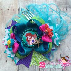 "Little mermaid OTT bow complete with ""dinglehopper"". Love the colors! #2prettygirlsbowtique"