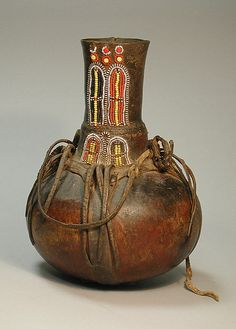 Vessel  Date:20th century Geography:Kenya Culture:Turkana peoples Medium:Calabash, beads, leather Dimensions:Height 10-1/2 in. Classification:Gourd-Containers