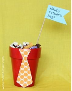 This idea is so cute and simple to make the kiddos could help: Candy filled tie pots for Father's Day. Find the how-tos HERE at Make It and Love It.