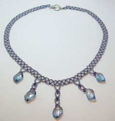 Crystal and netted Necklace Handcrafted in  Violet and Blue KerisKrystals @Etsy
