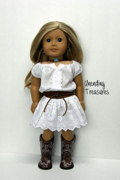 This 2 piece outfit will fit your favorite 18 inch doll who loves everything country.  1. The white peasant dress is made with an eyelet fabric. There is elastic in the waist, sleeves, and top so that it can easily be pulled on and off from the bottom. 2. The brown belt is made to open/close in the back with hook and loop tape.  All seams are serged for a clean finish and this was made in my smoke/pet free toy shop.  The doll, jewelry, and boots stay here with me.  I am not affiliat...