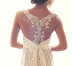 Lace Back Wedding Dresses - An eclectic lace back wedding dress with a neat bow, taken from the Anna Campbell 2012 Bridal Collection. Delightful!