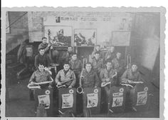 US army dance band. Richard Shill second row, middle holding trombone. I believe Wilson and Moul also in band. Givet, France 1945