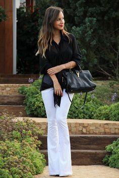 Sheer black blouse & white flares.