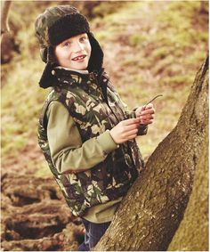 Boys Barbour Camo Quilted Gilet is a camo printed gilet with self welt pockets.