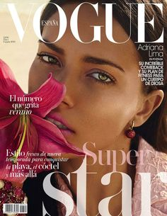 Adriana Lima wearing an Emporio #Armani blazer on the cover of Vogue Spain, May 2014