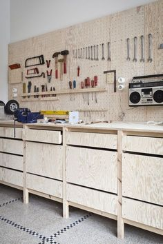 Bench is off floor. Pegboard is a good idea. I like the radio hanging up (keeps the bench clear). #woodworkingbench