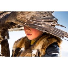 The Eagle Hunters of Mongolia Bayan Ulgii West Mongolia 2015.  During the communist period in Kazakhstan many Kazakhs fled for Mongolia settling down in Bayan Ulgii. Today in Mongolia they  continue an old tradition that is passed from generation to generation Eagle hunting .  They hunt small animals such as foxes and marmots with eagles  on horseback.  There are an estimated 250 eagle hunters in the Western Mongolian province.