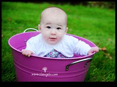 Baby in a bucket with a Bumbo seat.