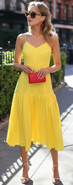 Top 10 Spring Trends to Know // How to Wear Trend #6: Yellow // click the image for all the details! // bright yellow eyelet fit and flare midi dress, cherry red woven clutch with turquoise stone closure, red and gold tassel earrings, metallic silver ankle strap heeled sandals, tortoise cat-eye sunglasses
