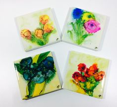 Set of four hand painted ceramic tile coasters. These tiles have been individually painted with alcohol inks and no two are exactly the same. The coasters have been sealed with a durable resin and are suitable for hot and cold drinks. Cork sheet backs each coaster to prevent damage to furniture. The nature of alcohol inks makes each and every piece unique. Each tile measures 10cm x 10cm Hand painted by Jayne Neill in her studio in McLaren Vale, South Australia.