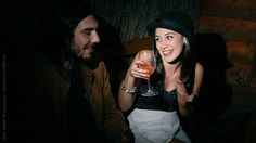 Young man and woman in conversation at a party by Gary Radler Photography