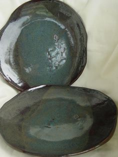Two Dinner Plates in Blue Rutile on dark clay Wabi Sabi. from Bright Leaf Pottery via Etsy.
