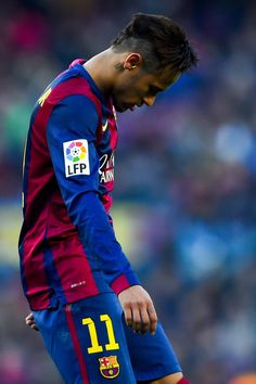 Neymar of FC Barcelona looks down dejected during the La Liga match between FC Barcelona and Malaga CF at Camp Nou on February 21, 2015 in Barcelona, Catalonia.