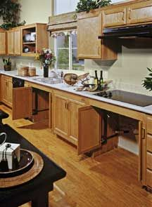 Retractable doors to allow countertop access to cooktop and sink for those seated or in wheelchairs