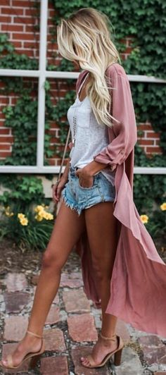 Ripped jean shorts, loose white pocket tee, long kimono and nude single strap heels