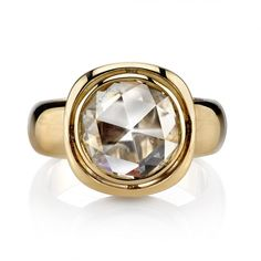 2.42ct JK/SI Rose cut diamond set in a handcrafted 18K yellow gold mounting. Smooth lines, bold metal, and unique airline space give this ring a contemporary yet classic look.