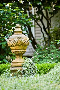I love the texture of this classical finial. This is more my idea of yard art!
