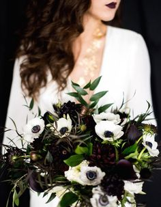 Break tradition by using chic dark and moody florals at your fall or winter wedding, like this gorgeously dark bouquet!