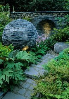 """Lakeland slate ball. Ferns. Niche in wall. Lighting. decorative modern Design: Andrew Loudon.   """"That's no slate ball.   That's a space station."""""""
