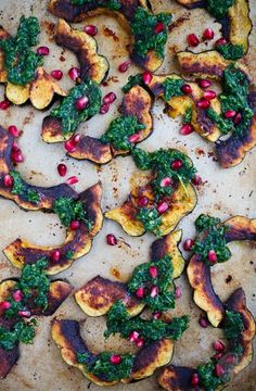 Roasted acorn squash with arugula pesto and pomegranate is a great side dish addition to any meal! So colorful and vibrant! Rosh Hashanah. Jewish Holiday Inspiration