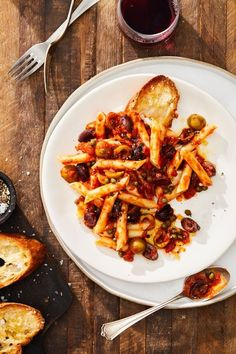 Puttanesca is a traditional Italian pasta sauce famous for its bold and briny flavor. Learn how to make this quick and easy version. Seafood Pasta Recipes, Easy Pasta Recipes, Sauce Recipes, Easy Meals, Olive Recipes, Italian Recipes, Hot Cheese Dips, Vegetarian Recipes, Cooking Recipes