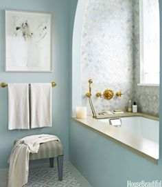Creating an idyllic bath for a Long Island home, designer DD Allen choose a blue palette but did not limit herself to one shade. The custom watery blue of the polished Venetian plaster walls picks up the blue in the floor tiles. Waterworks Classic Undermount tub. Venetian Plaster by JJ Snyder Studio. Architecture by Michael Pierce.