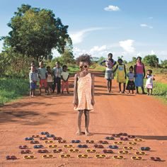In his Toy Stories photo series, Italian photographer Gabriele Galimberti spent 18 months photographing children from around the world and their most prized toy possessions. Here is Maudy from Kalulushi, Zambia. Look up the serie of photos ! Toy Story, Kids Around The World, Around The Worlds, Kid Poses, Being In The World, Photo Series, Photo Essay, Photographing Kids, Stories For Kids