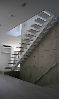Floating stair company offering prefab stairs, frameless glass railings and more modern stair needs