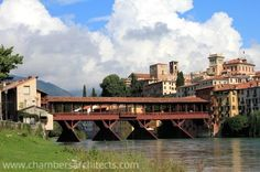 Ponte degli Alpini, designed by Andrea Palladio, straddles a river running through Bassano del Grappa at foot of Monte Grappa - See more at: http://chambersarchitects.com/blog/7-sustainable-design/127-basano-del-grappa-and-palladio-bridge.html#sthash.azHQUj7k.dpuf - And find more photos like this at: http://chambersarchitects.com/blog.html