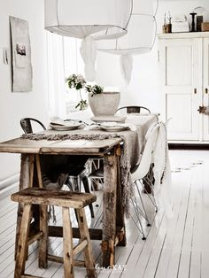 = cotton pendants and wood table