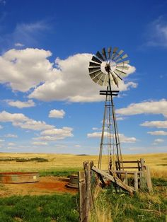 Brilliant blue sky and an old windmill water well for farmers and ranchers out on the plains. Farm Windmill, Windmill Art, Windmill Drawing, Country Life, Country Roads, Country Living, Old Windmills, Country Scenes, Water Tower