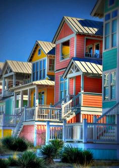 Paint A Tropical Color- Painting your house or a portion of the house in a tropical color will give the house instant coastal curb appeal. L...