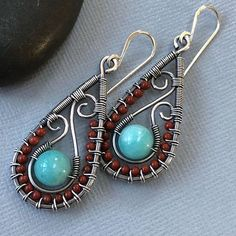One of a kind silver paisley earrings with Amazonite. These earrings are perfect to spice up your casual / business casual outfit. These earrings are hand forged from Sterling Silver wire and embellished eith little 2 mm Jasper and 8 mm Amazonite beads. They are oxidized and tumbled to get this