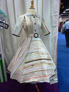 Quilt Market Spring 2013 Reflections by Alicia.  How cool is this dress made of fabric salvage?   I absolutely love it.