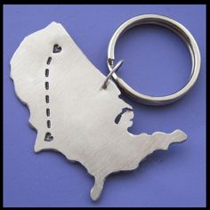 Long distance love key chain on etsy  This is actually almost exactly the distance. Just move that bottom heart up north a bit.