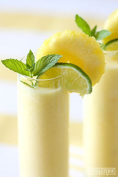 Pineapple chunks, ice, lime juice, coconut milk, & rum. Seriously...YUMMO.