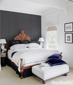 """In the master bedroom, Ralph Lauren Home's Sloane Stripe wallpaper """"provides relief from the heavily ornamented bed,"""" Fulk says. Antique Asian hatboxes serve as nightstands. Fulk's smart double Roman shade offers variable light control by layering opaque linen duck over translucent grass cloth.   - HouseBeautiful.com"""