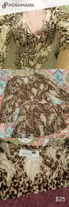 Leopard print wrap top Tunic length wrap top. Three quarter sleeves,  easy care poly spandex. Beautiful abstract animal print. Liz Lange's line for HSN, not maternity. Liz Lange Tops Blouses