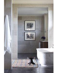 nice looking bathroom, like the dark floor, white tub, lighter grey walls