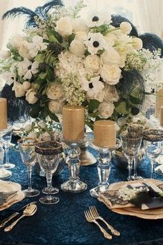 Navy blue and gold reception table - love the beautiful white floral centerpiece #wedding #gold #glam #glitter #blue