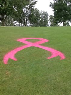 Rally for the Cure ribbon on the fairway.