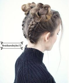 This season's most popular half-up hairstyle combines two ever popular trends – braids and bun. A narrow Mohawk braids into double or single half-up top knots is the latest and the coolest twist on half-up braids. This hairstyle is unbelievably cool and out of ordinary, yet it is very easy to do. No wonder it