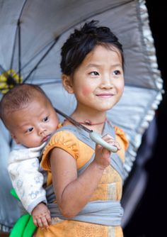 Laos…….SHE IS JUST SO VERY PROUD SHE GETS TO CARE FOR HER BABY BROTHER……….ccp