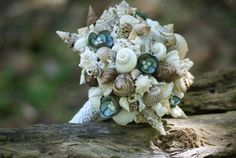 Not flowers, but it's a bouquet! Limpet Seashell Bouquet / Beach Bouquet by SLYCreations on Etsy, $117.00