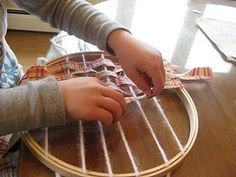Montessori weaving with an embroidery hoop, yarn and fabric