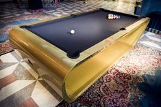 Toulet Black Light Billiard Tables combine a streamlined modern design for a pool table with tons of available amenities, customizations, colors and lighting