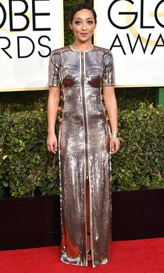 RUTH NEGGA wears a highly constructed silver sequin short-sleeve Louis Vuitton gown with a front zip and Fred Leighton x Gemfields ruby cuff.
